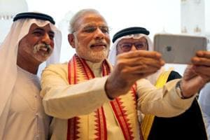 Prime Minister Narendra Modi takes a selfie during his two-day visit to the UAE on August 16, 2015.