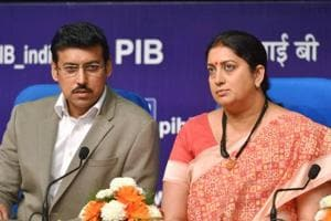Information and broadcasting minister Smriti Zubin Irani (R)with minister of state Col Rajyavardhan Rathore in New Delhi.