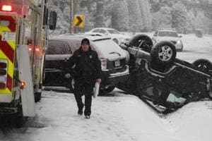 Snowstorm, deep freeze leaves four dead in US South