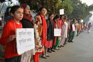 Residents of Hisar, form a human chain, holding up placards against the increasing rapes in Haryana.
