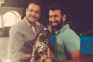Ravi Shastri and Cheteshwar Pujara trolled for posing with leopard...