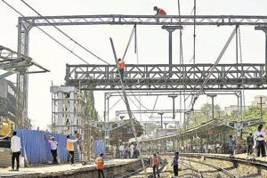 The armymen and railway workers lay a girder for a new foot overbridge in Ambivli in Kalyan on Thursday.