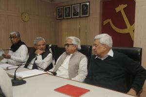 CPI(M)leaders (L to R) Tripura chief minister  Manik Sarkar, Sitaram Yechury, Biman Bose and Prakash Karat at the beginning of the central  committee meeting in Kolkata on Friday.