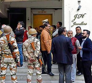 Police, MCD officials and shopkeepers at Sundar Nagar Market in New Delhi on Friday.