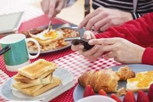 Shrinking meal times, increasing presence of gadgets at dinners, finds...