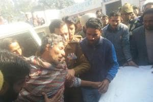 A civilian injured in Pakistani shelling in RSPura sector of Jammu district  being taken to a hospital on Saturday.