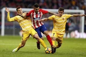 Atletico Madrid title hopes hit by Girona, Montella earn Sevilla win