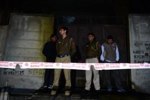 Police stand guard in front of a plastic factory in the Bawana industrial area on the northern edge of New Delhi on January 20, 2018 after a fire killed at least 17 workers.