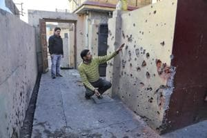 Villager shows a damaged section of his house after shelling from the Pakistani side on the India-Pakistan international border at Arnia Sector about 45km from Jammu on Saturday.