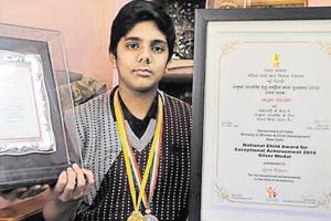 Ayush Kishore shows his awards, in Bhopal.