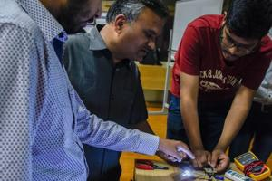 BN Chaudhari (centre) interacting with students at the Tesla workshop at COEP on Sunday.