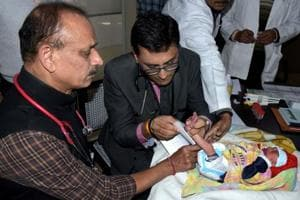 JK Lone Hospital Medical Superintendent Dr Ashok Gupta (left) with Newborn Screening Laboratory in-charge Dr Priyanshu Mathur on Monday.
