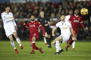 Premier League: Liverpool F.C. suffer surprise defeat against Swansea...