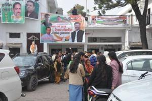 People outside Congress state headquarters in Dehradun.