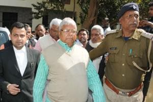 RJD president Lalu Prasad arrives at a CBI court in Ranchi in connection with a fodder scam case.