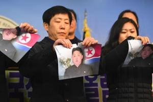 Activists rip Kim Jong Un's photo to protest North Korea's...