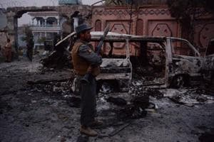 Afghan security forces inspect the site of attack on British charity Save the Children office in Jalalabad.