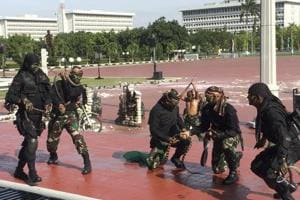 Indonesian forces drink snake blood, roll in glass during...