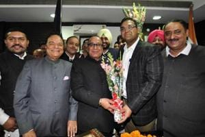 MC commissioner Basant Garg welcoming newly elected mayor Jagdish Raja at the MC office in Jalandhar on Thursday.