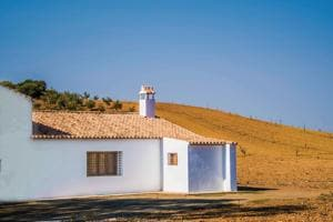 A typical Andalusian farmhouse in the middle of rolling hills