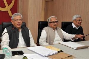 CPI(M) leaders Sitaram Yechury, Biman Bose and Prakash Karat during the party