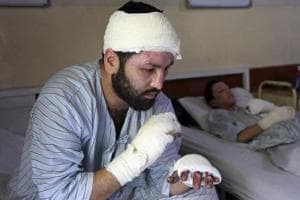 Photos: Survivors of IS Kabul attacks struggle to cope a month on