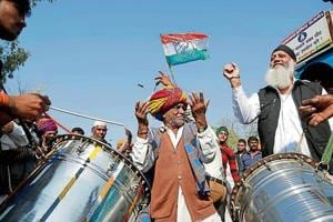 Congress supporters celebrate after filing of nominations for by-elections in Ajmer.