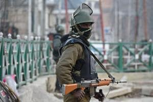 An Indian paramilitary trooper stands guard on the eve of Republic Day in Srinagar.