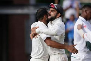 India captain Virat Kohli (R) celebrates with teammates after winning the third Test against South Africa at Wanderers in Johannesburg on Saturday.
