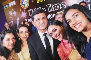 Prakash Padukone with daughter Deepika Padukone (rnd right), PVSindhu (right) and family at the function organised by Badminton Associated of India (BAI) to award him its inaugural Lifetime Achievement Award in New Delhi on Monday.