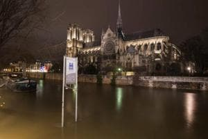 Floodwaters hit peak in Paris, now threaten Normandy