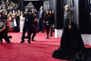 On Grammys red carpet, white roses are the motif, women's equality the...