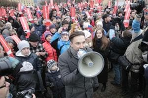 Navalny freed after thousands protest against Putin and 'pseudo-polls'...