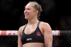 Ronda Rousey leaves UFC for WWE after cameo at women's Royal Rumble