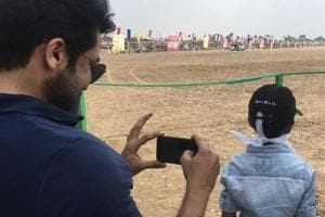 Suriya and son Dev watch rekla race at the shooting spot of Karthi's...