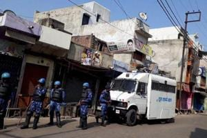 Personnel of the Rapid Action Force keep vigil in Kasganj on Sunday.