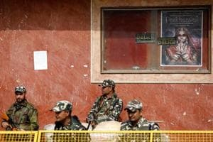 Security personnel stand guard outside a theatre after the release of Hindi film Padmaavat in New Delhi.
