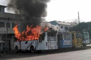 A bus set on fire by a group of people who went on a rampage after cremation of a young man killed on Friday during the Tiranga bike rally, in Kasganj on Saturday.