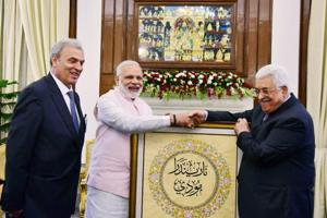 File photo of President of Palestine, Mahmoud Abbas presenting  Prime Minister Narendra Modi a portrait with his name inscribed in Arabic  in New Delhi during his visit in May 2017.