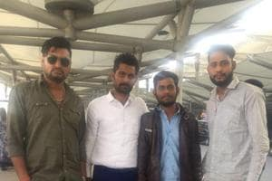 Vikramaditya Rathore (second from right) on his arrival at the IGI airport in Delhi on Wednesday evening.