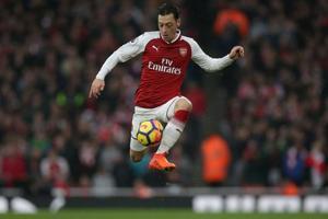 Mesut Ozil commits long-term future to Arsenal