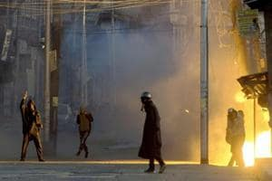 A teargas shell explodes near the protesters who were clashing with security forces following a protest against the alleged killing of two youth Army firing in Shopian district of South Kashmir, in Srinagar on Sunday.