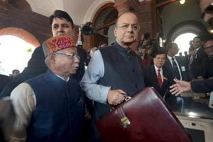 Union Minister for Finance and Corporate Affairs Arun Jaitley with Minister of State for Finance Shiv Pratap Shukla arrives at Parliament House to present the Union Budget 2018-19 in New Delhi on Thursday.