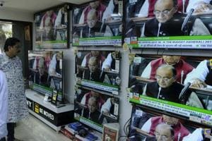 People watch Union Budget presented in Parliament last year.