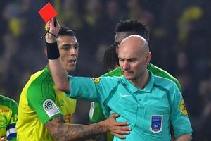 Tony Chapron, French referee who kicked footballer, banned for three...