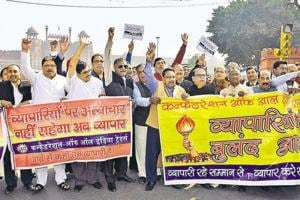 Members of the Confederation of All India Traders protested against the sealing drive near Red Fort on Saturday.
