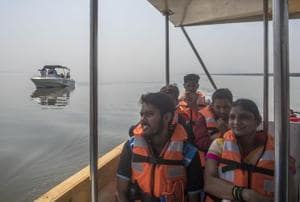 Visitors take the first boat ride of flamingo sanctuary in Thane creek on Thursday, February 1.