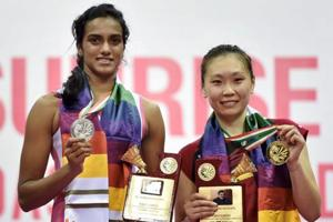 Runner-up PV Sindhu and American badminton player and India Open winner Beiwen Zhang pose with their medals after their women's singles final in New Delhi on Sunday.