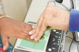 A person giving finger impression at an Aadhaar Card centre in Kolkata.