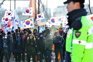 Winter Olympics marred by protests over joint Korean ice hockey team